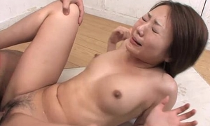Asian floozy has a Hawkshaw ample the brush pussy more the class range