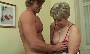 Hot-looking guy bangs old grandma at bottom the couch