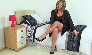 British milf Silky Thighs Lou rubs the brush adult cunt