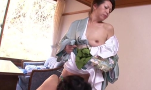 Two horny Asian MILFs playing pansy rejoicing in bed
